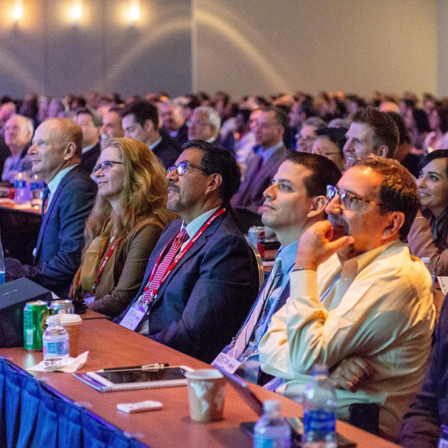 Crowd of attendees looking up at the stage of the ASCRS ASOA Annual Meeting